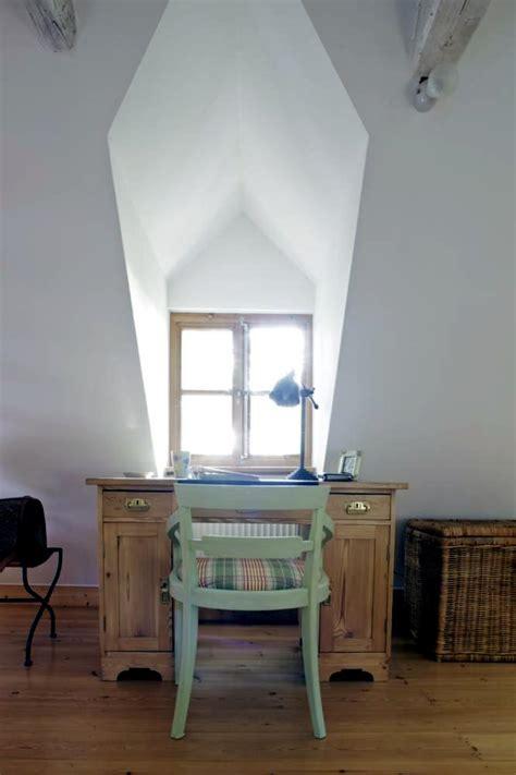 antique desk in front of the window interior design