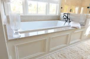 Traditional master bathroom with roman shade by construction resources