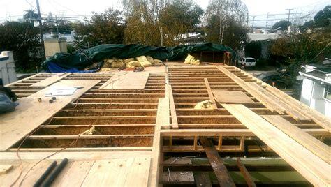 installing a new floor joist system on an existing house