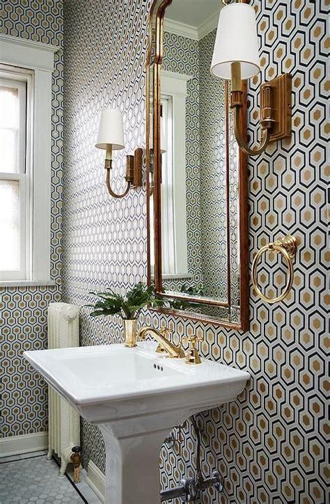 gold mirror bathroom fabulous powder room boasts walls clad in cole son hicks