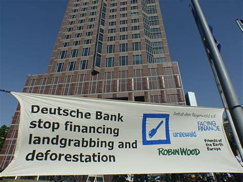 deutsche bank leverkusen die erde darf kein schwarzer planet werden protest