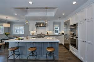 beautiful Designing Kitchen Cabinets #1: luxury-kitchen-with-white-shaker-cabinets-blue-island-with-white-marble-counters-and-globe-pendant-lights.jpg