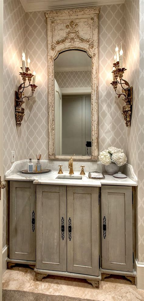 french powder room   mirror sconces