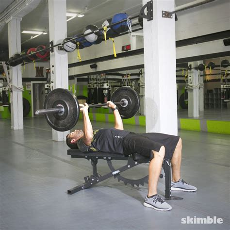 how to do bench press with dumbbells barbell bench press exercise how to workout trainer by skimble
