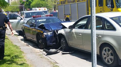 state trooper hit on head two injured after car crashes head on into parked state