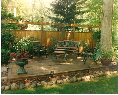 backyard wood patio backyard privacy wall with deck attached landscaping