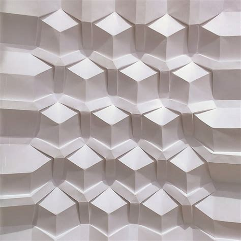 Folded Paper Patterns - tessellating patterns formed from intricately folded paper