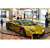 Shoppers Admire Gold Plated Lamborghini In Beijing Mall  Maximum BHP