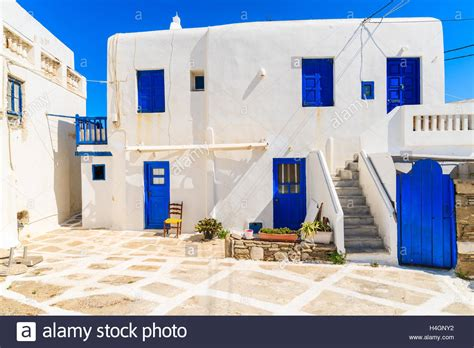greek house typical greek house blue windows and doors on whitewashed street in stock photo