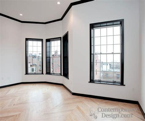 black and white wall white walls black trim