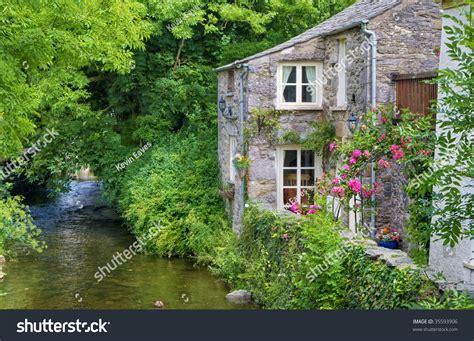 quaint cottage on bank stock photo 35593906