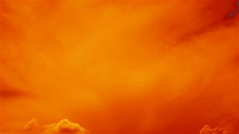 subtle color subtle clouds abstract background in orange color stock