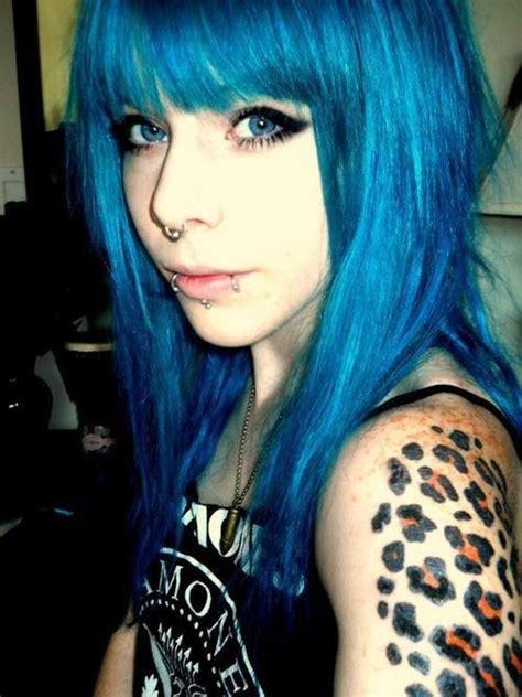 tattoo girl blue hair blue coloured hair pretty girl with a fierce literally