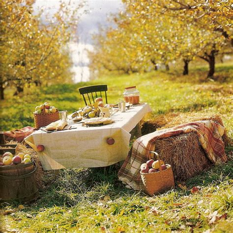 autumn home decorations and yellow apples as an autumn home and table setting