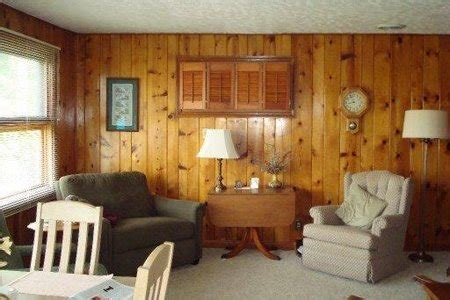 how to decorate wood paneling interior design is there a wallpaper i can use to hide