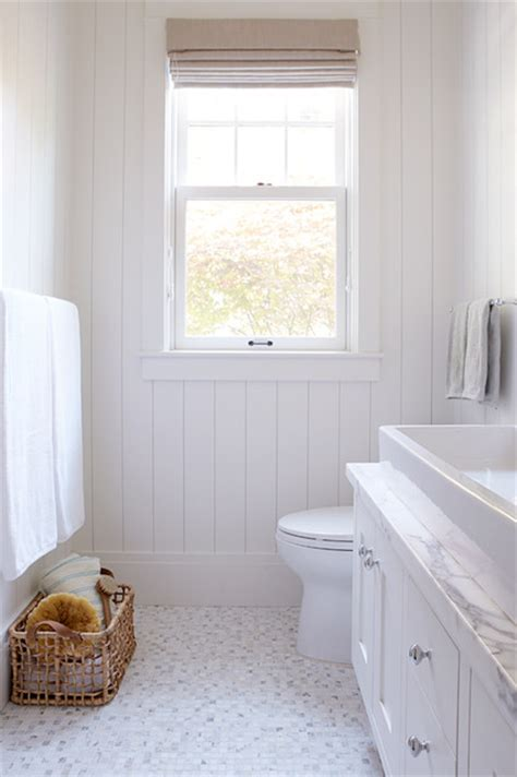 traditional bathrooms flooring white bathroom with tile floor and lots of light