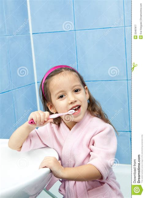 girl in the bathroom tooth washing little girl in bathroom royalty free stock