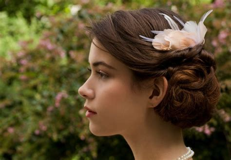 wedding hairstyles for hair with fascinator elegantly twisted wedding hairstyle with fascinator