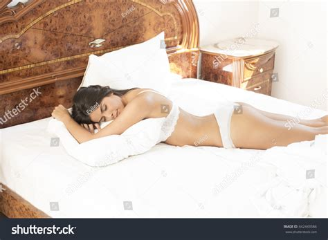 lying in bed or laying in bed young woman lying bed morning stock photo 442443586