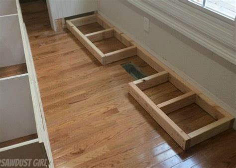 how to level kitchen base cabinets how to install a cabinet base with a floor vent sawdust