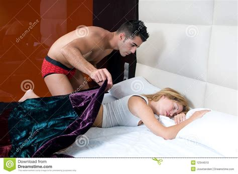 man and woman sexuality in bedroom woman sleeping and man in silence in her bedroom stock