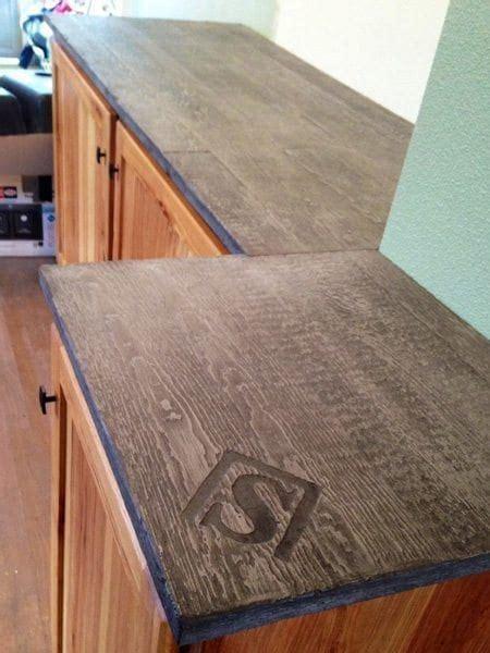 brown wood grain concrete counter top  logo