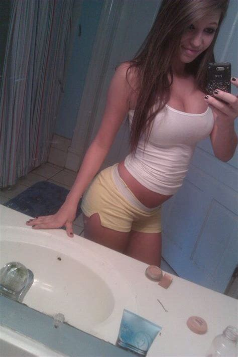 teen selfie bathroom curvy brunette teen in tight white top and tiny yellow