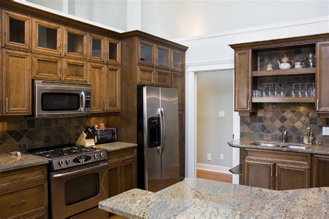 kitchen backsplash with oak cabinets and black appliances oak kitchen cabinets with slate appliances quicua com