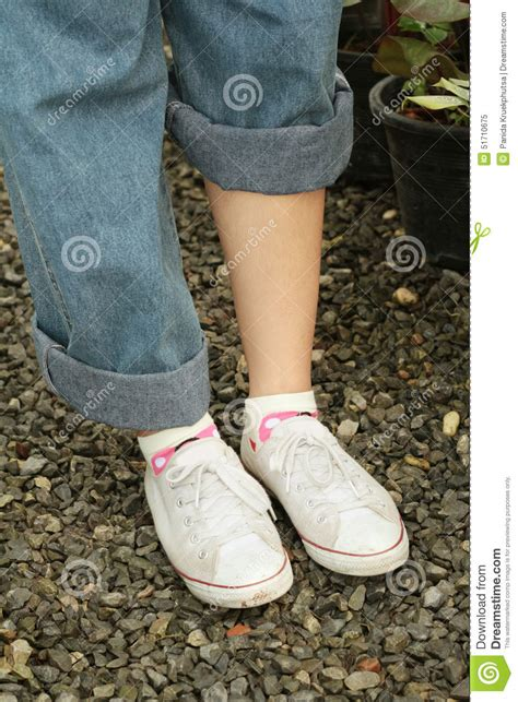 wearing white shoes with blue stock image