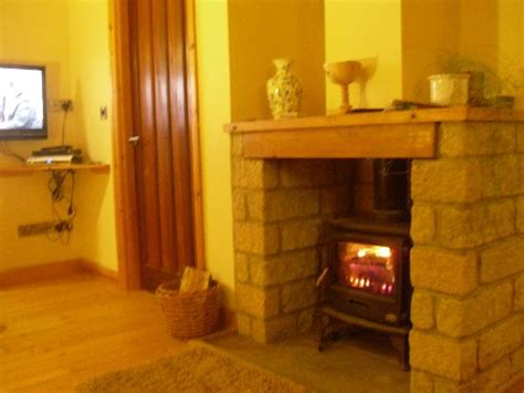 wood stove in living room wood burning stove in the living room picture of dalby forest log cabins pickering tripadvisor