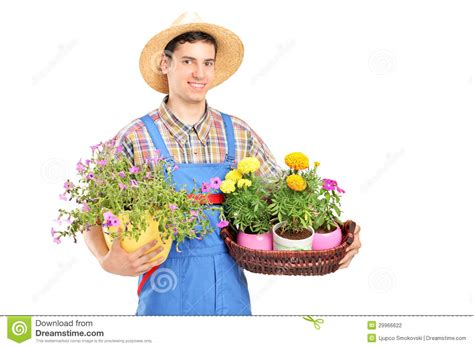 How To Be A Gardener by Gardener With A Straw Hat Holding Flower Plants Stock