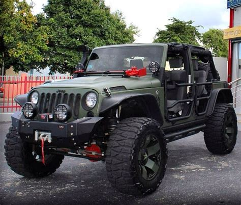 army green jeep rubicon army green and lifted modified hood changed the bumper and