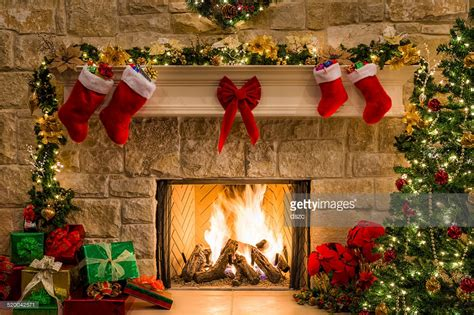 free fireplace christmas photos fireplace tree hearth lights and decorations stock photo getty images