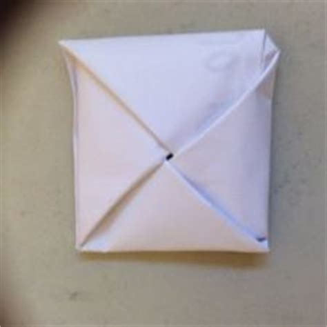 How To Fold Paper Into 10 Squares - how to fold paper into a secret note square 10 steps