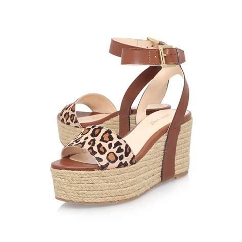 nine west high heel sandals nine west edoile3 high heel sandals in brown lyst