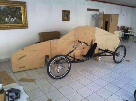 porsche bicycle car uses cardboards and a bike to build a replica of