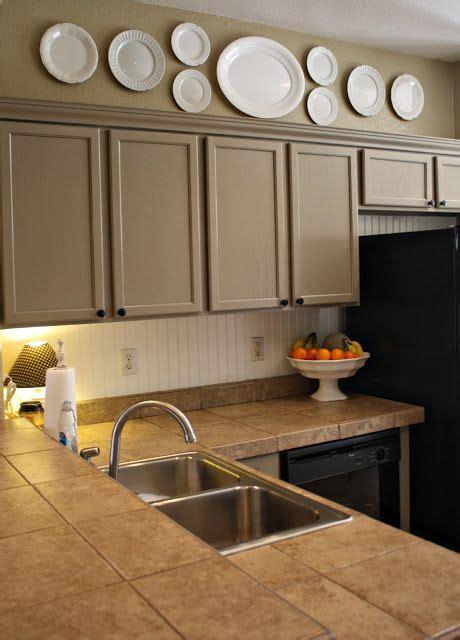clarendon hanging white plates above kitchen