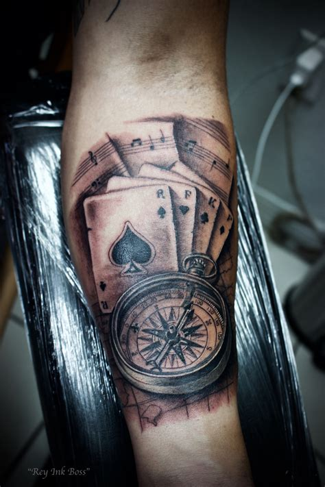 compass tattoo with cards and music tattoo art by rey