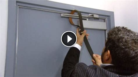 Barricade The Door by Tightens His Belt Around A Door Hinge But The Reason