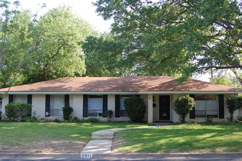 white ranch house fantastic ranch house curb appeal with white brick pillars and dark brown paneled
