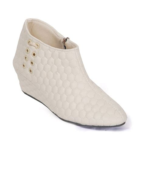 hitanksha harshit white ankle length boots price in india