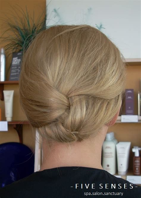 french braid for military looks like a loose french braid that s been tucked back
