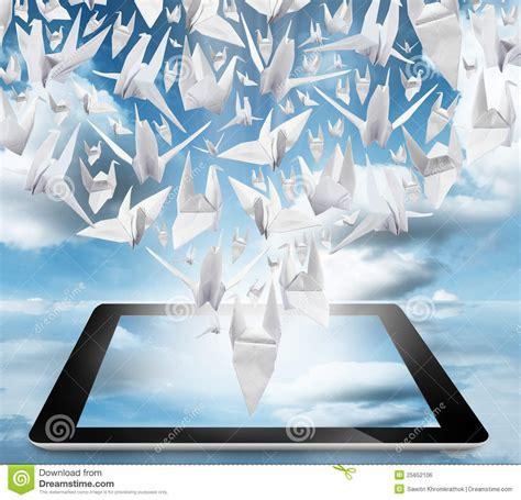 Origami In Flight - origami birds in flight on tablet pc royalty free stock