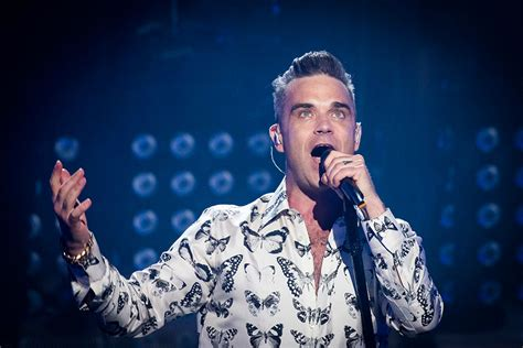 reveal robbie williams books robbie williams reveals teddy is completely