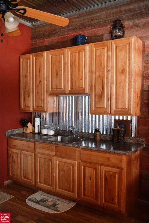 kitchen cabinets knotty alder knotty alder kitchen cabinets dark granite counter tops