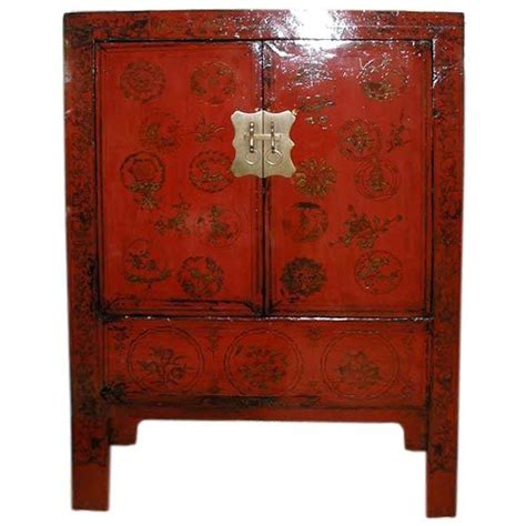 red or black lacquer gilt fine red lacquer cabinet with gold gilt floral motif for