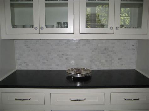 marble backsplash kitchen glass front cabinets glass knobs marble mini tile