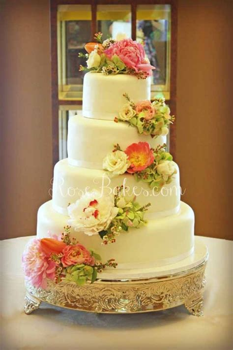 flowers for wedding cakes real white wedding cake with cascading fresh flowers bakes