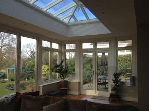 Small Outdoor Kitchen interior of wood orangery with roof lantern side