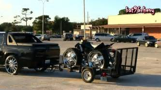 chevy avalanche truck on 28 s towing a 4 wheeler on 26 s